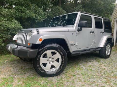 2011 Jeep Wrangler Unlimited for sale at The Car Store in Milford MA