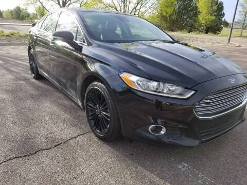 2016 Ford Fusion for sale at Red Rock's Autos in Denver CO