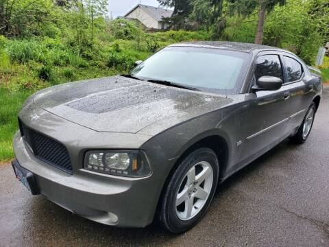 2010 Dodge Charger SXT for sale at Road Star Auto Sales in Puyallup WA