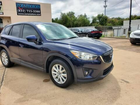 2013 Mazda CX-5 for sale at Zora Motors in Houston TX