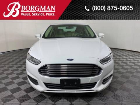 2016 Ford Fusion Hybrid for sale at BORGMAN OF HOLLAND LLC in Holland MI