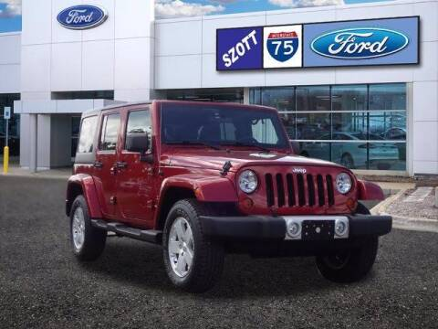 2012 Jeep Wrangler Unlimited for sale at Szott Ford in Holly MI