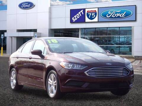 2018 Ford Fusion for sale at Szott Ford in Holly MI