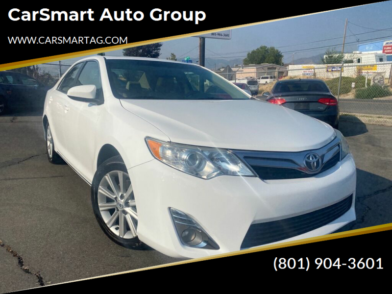 2014 Toyota Camry for sale at CarSmart Auto Group in Murray UT