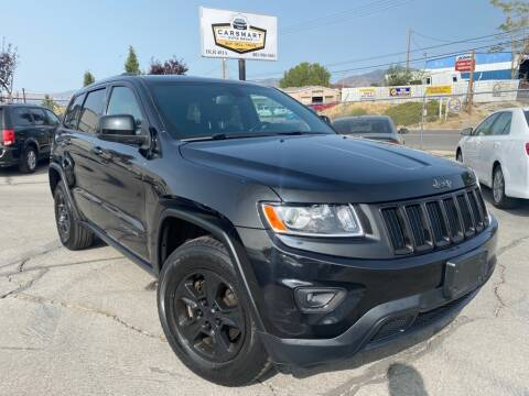 2014 Jeep Grand Cherokee for sale at CarSmart Auto Group in Murray UT