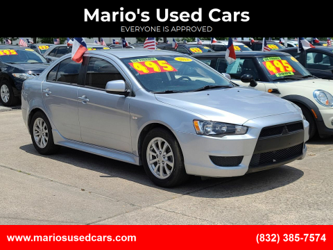 2014 Mitsubishi Lancer for sale at Mario's Used Cars in Houston TX