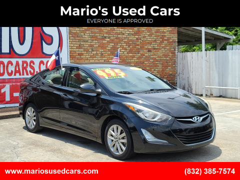 2014 Hyundai Elantra for sale at Mario's Used Cars - South Houston Location in South Houston TX