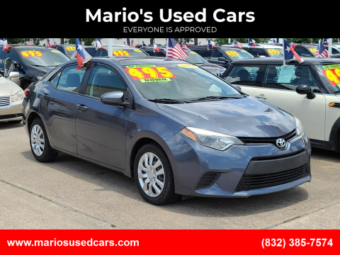 2014 Toyota Corolla for sale at Mario's Used Cars in Houston TX