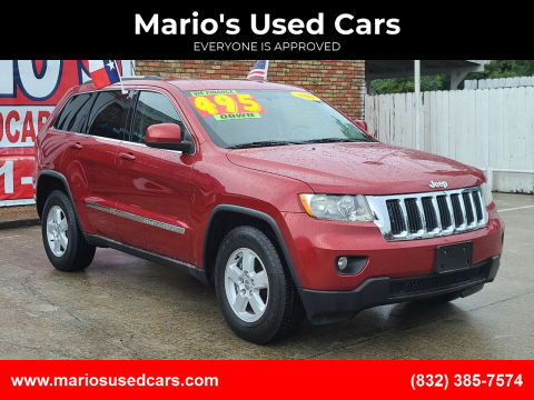 2011 Jeep Grand Cherokee for sale at Mario's Used Cars - South Houston Location in South Houston TX
