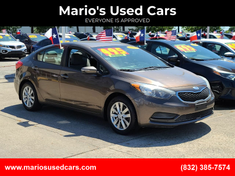 2014 Kia Forte for sale at Mario's Used Cars in Houston TX