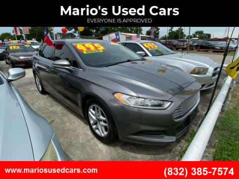 2014 Ford Fusion for sale at Mario's Used Cars - South Houston Location in South Houston TX