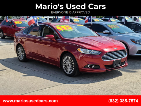 2015 Ford Fusion for sale at Mario's Used Cars in Houston TX