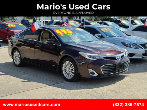 2014 Toyota Avalon Hybrid for sale at Mario's Used Cars in Houston TX
