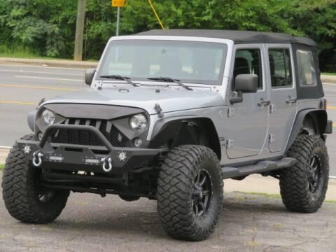 2014 Jeep Wrangler Unlimited for sale at Marietta Auto Mall Center in Marietta GA