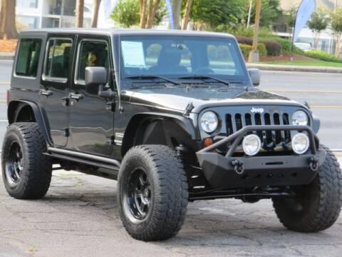 2012 Jeep Wrangler Unlimited for sale at Marietta Auto Mall Center in Marietta GA