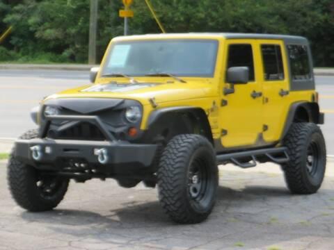 2011 Jeep Wrangler Unlimited for sale at Marietta Auto Mall Center in Marietta GA