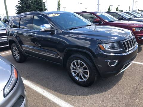 2014 Jeep Grand Cherokee for sale at MILLENNIAL AUTO GROUP in Farmington Hills MI