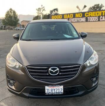 2016 Mazda CX-5 for sale at Global Auto Group in Fontana CA