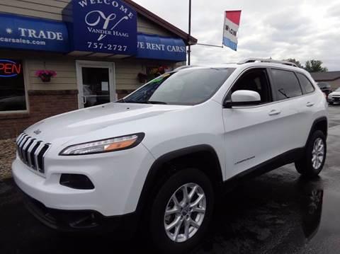 2014 Jeep Cherokee for sale at VanderHaag Car Sales LLC in Scottville MI