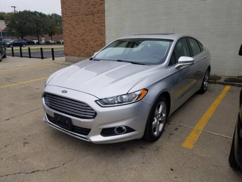 2013 Ford Fusion for sale at Madison Motor Sales in Madison Heights MI