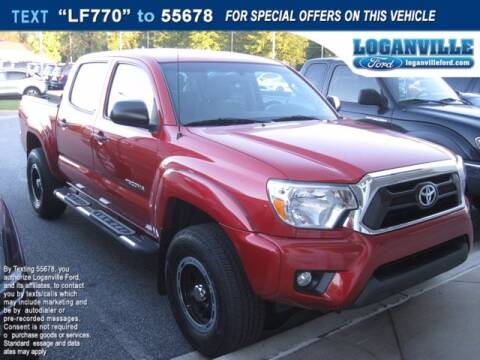 2015 Toyota Tacoma for sale at Loganville Ford in Loganville GA