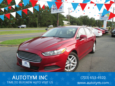 2014 Ford Fusion for sale at AUTOTYM INC in Fredericksburg VA