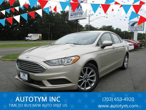 2017 Ford Fusion Hybrid for sale at AUTOTYM INC in Fredericksburg VA