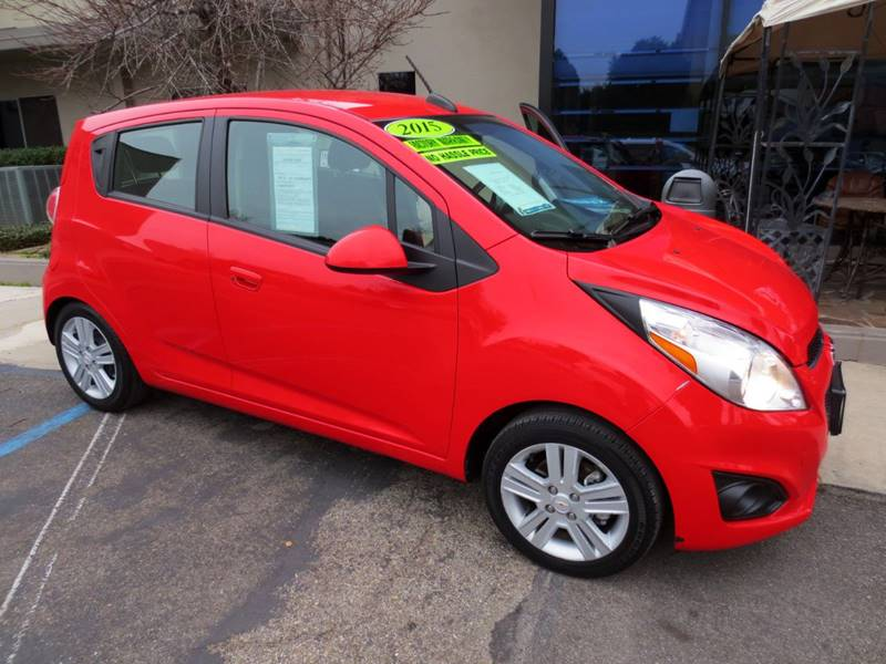 2015 CHEVROLET SPARK 1LT CVT 4DR HATCHBACK red  great color combo gets 39 mpg highway and 30 m