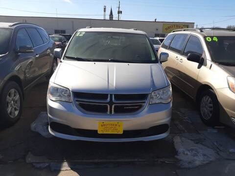 2012 Dodge Grand Caravan SXT for sale at Brothers Used Cars Inc in Sioux City IA