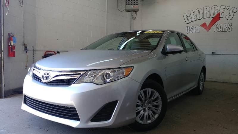 2012 TOYOTA CAMRY LE 4DR SEDAN classic silver metallic wow check out those gas savings sips gas