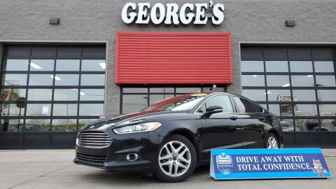 2014 Ford Fusion for sale at George's Used Cars - Pennsylvania & Allen in Brownstown MI