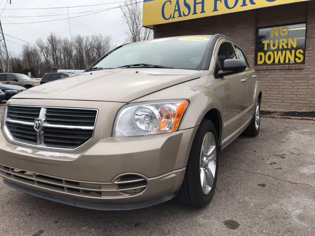 2010 DODGE CALIBER SXT 4DR WAGON light sandstone metallic hold on to your seats in a class by it