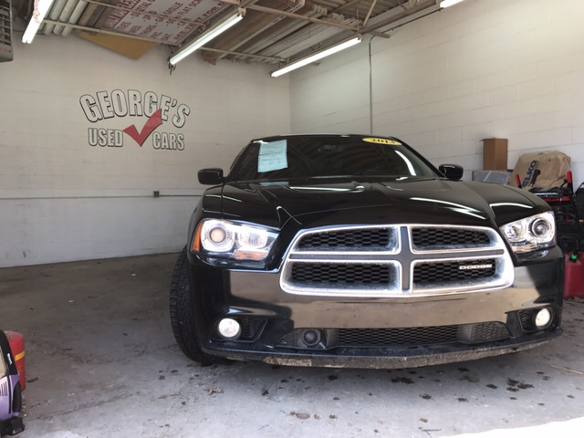 2012 DODGE CHARGER RT AWD 4DR SEDAN black carfax 1 owner and no accidents awd hold on to your