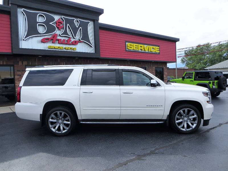 2015 Chevrolet Suburban for sale at B & M Auto Sales Inc. in Oak Forest IL