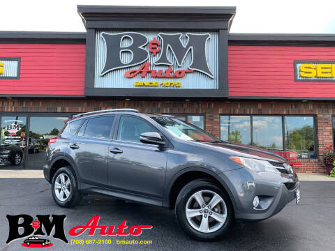 2015 Toyota RAV4 for sale at B & M Auto Sales Inc. in Oak Forest IL