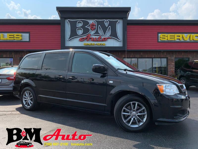 2014 Dodge Grand Caravan for sale at B & M Auto Sales Inc. in Oak Forest IL