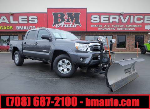 2013 Toyota Tacoma for sale at B & M Auto Sales in Oak Forest IL