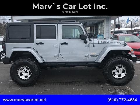 2013 Jeep Wrangler Unlimited Sahara for sale at Marv`s Car Lot Inc. in Zeeland MI