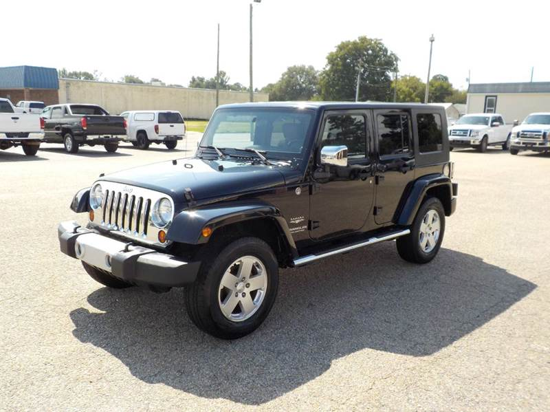 2010 Jeep Wrangler Unlimited for sale at Young's Motor Company Inc. in Benson NC