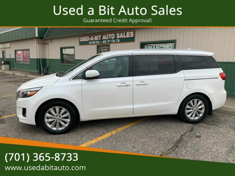 2015 Kia Sedona for sale at Used a Bit Auto Sales in Fargo ND