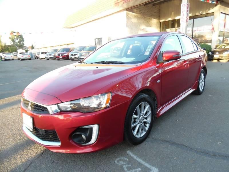 2016 MITSUBISHI LANCER ES 4DR SEDAN CVT red need financing we can help call now call today ca