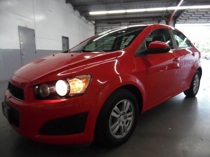 2014 CHEVROLET SONIC LT AUTO 4DR SEDAN red need financing we can help call now  call today  c