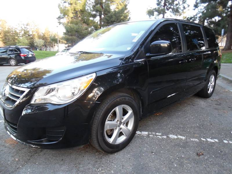 2010 VOLKSWAGEN ROUTAN SE 4DR MINI VAN W RAND NAV black need financing we can help call now