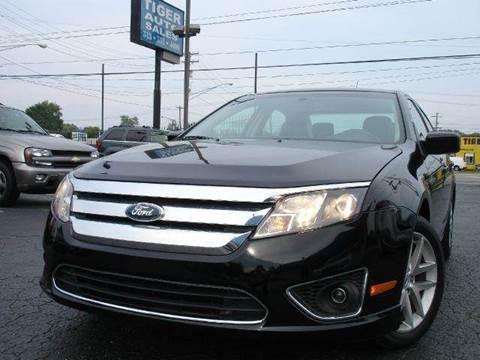 2012 Ford Fusion for sale at TIGER AUTO SALES INC in Redford MI
