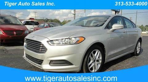 2013 Ford Fusion for sale at TIGER AUTO SALES INC in Redford MI