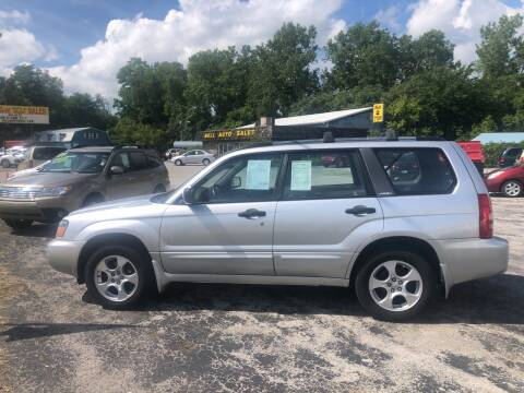 2003 Subaru Forester for sale at BELL AUTO & TRUCK SALES in Fort Wayne IN
