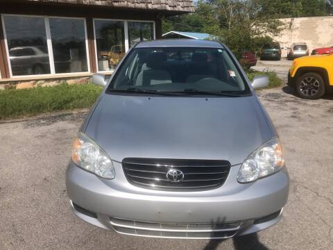 2004 Toyota Corolla for sale at BELL AUTO & TRUCK SALES in Fort Wayne IN