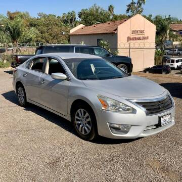 2013 Nissan Altima for sale at Auto Source in Banning CA