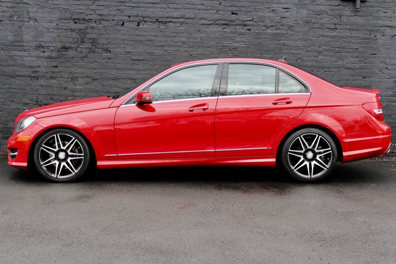 2013 Mercedes-Benz C-Class C 300 Sport 4MATIC AWD 4dr Sedan w PREMIUM 1 PACKAGE, MULTIMEDIA PACKAGE, SPORT PACKAGE, NAVIGATION, REAR-VIEW CAMERA, PARK ASSIST, AND HARMAN KARDON PREMIUM SOUND - Great Neck NY