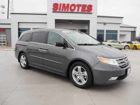 2013 Honda Odyssey for sale at SIMOTES MOTORS in Minooka IL